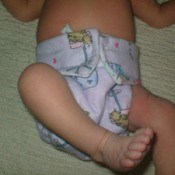 Baby with cloth nappy.