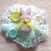Pin with bunny and buttons on lace backing