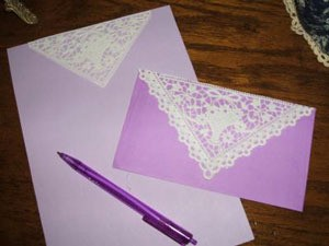 Lavender stationery with doily added to paper and envelope.