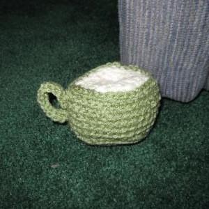 Sage green crochet coffee mug.