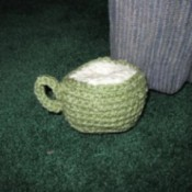 Sage green crochet coffee mug.