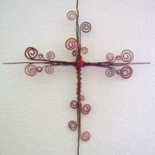 A wire cross with curlicues.