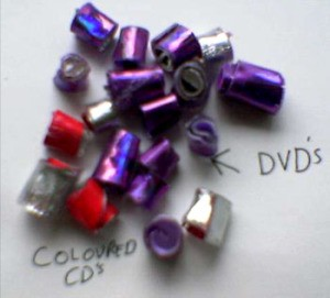 Beads made from recycled DVDs and CDs.