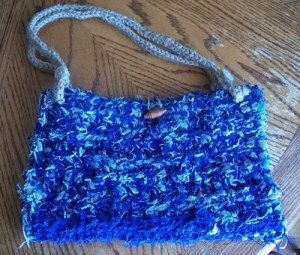 Blue denim crocheted purse.