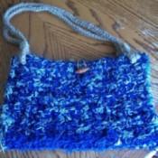 Blue denim crocheted purse.