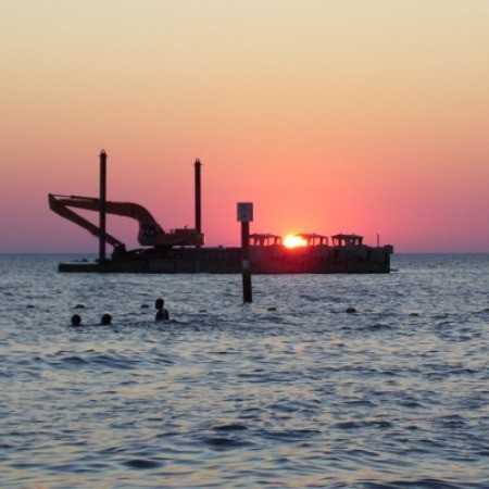 Sunset over the ocean in Virginia Beach, VA.