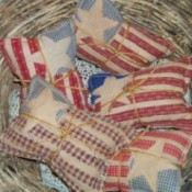 Primitive Applique Flag Pillows - Flags in basket.