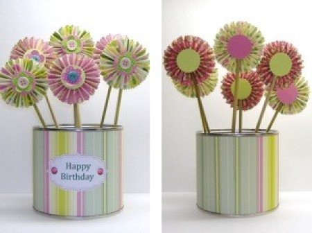 Paper flowers in recycled peanut can.