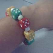 Dice and white bead bracelet.