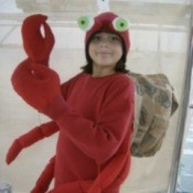 Girl wearing a hermit crab costume.