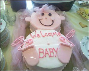 Cake Shaped Like A Baby With Pink Frosting