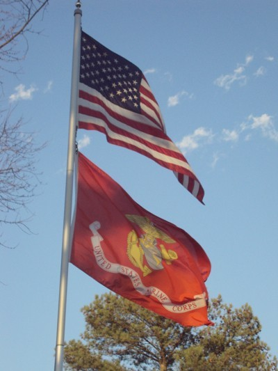 US Flag and US Marine Corps flag flying.