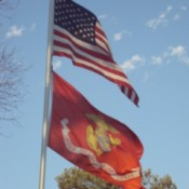 US Flag and US Marine Corps flag flying.