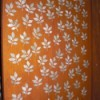 Door decorated with peel and stick leaves.