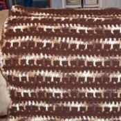 Brown and white crochet lapghan.