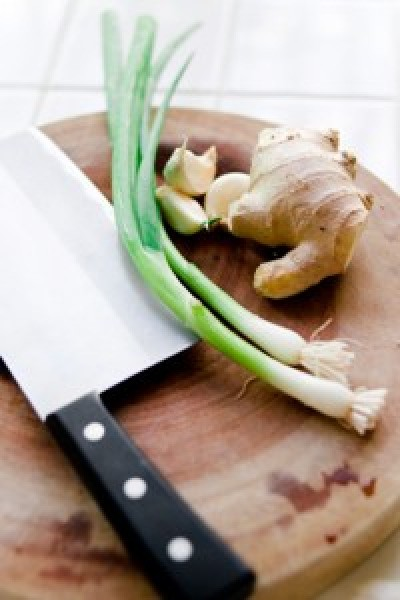 cutting board, knifeginger and scallions