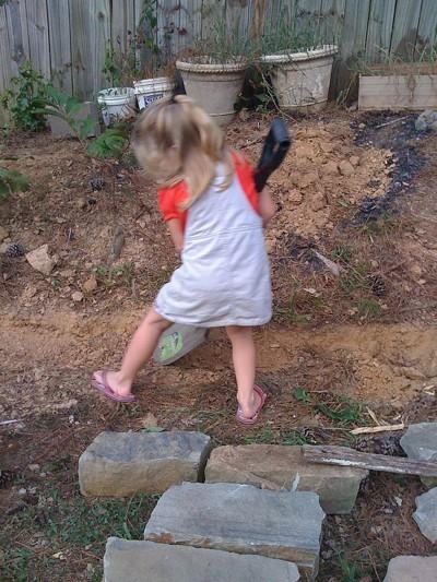 Little girl shoveling