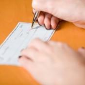 Woman writing a check.