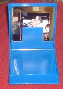 Blue floppy disc case with photo inside.