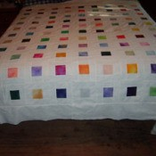 Quilt on bed.