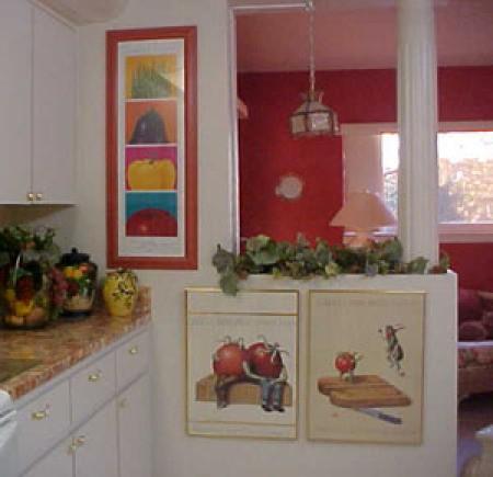 Prints hung on wall and half wall.
