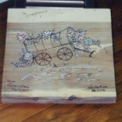 wood burned covered wagon and floral plaque