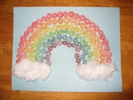 Cereal rainbow with cotton ball clouds.