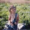 Boy in field of bluebonnets.
