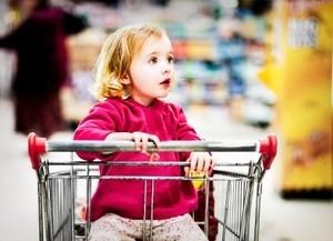 Young girl in shopping cart