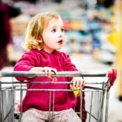 Young girl in shopping cart