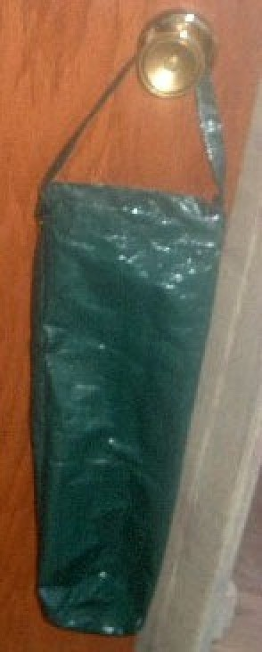 green plastic hanging planter