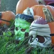 masks on pumpkins