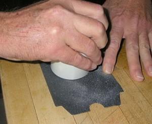 Sanding a craft part.