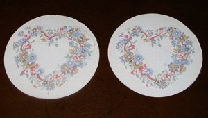 Round coasters with heart shaped flower pattern.