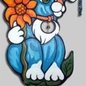 A blue cat plywood yard art piece.