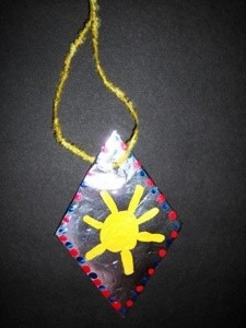 kids' craft necklace with sun painted on diamond shape