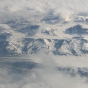 Looking down on snowy mountains.