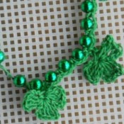 shamrocks crocheted onto plastic bead necklace