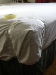 Tape around corner of mattress.