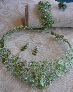 intricate light green wire necklace, bracelet, and earrings