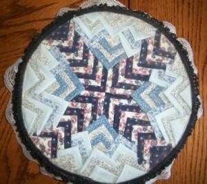 folded fabric decorated tin