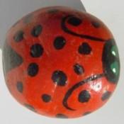 Rock painted to look like ladybug.