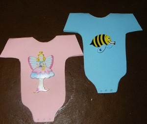 Pink and blue onesie invitations.