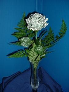 How to Fold a Dollar Bill into a Flower | GuideCraft Blog | 300x225