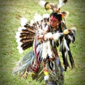 A First Nations tribe member, dressed in traditional costume.