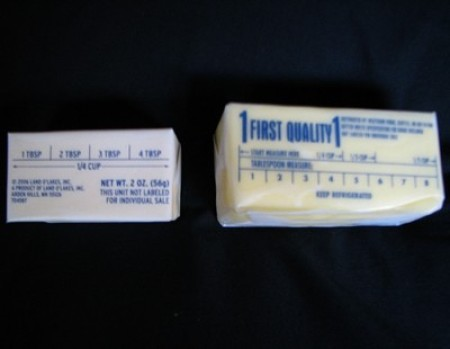 Two sticks of butter in different sizes.