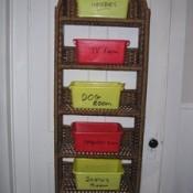 A clutter organizer hanging on a door.