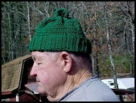 man wearing a green ski hat