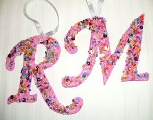 "The letter ""R"" and ""M"" decorated and ready to hang on a Christmas tree."