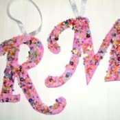 """The letter """"R"""" and """"M"""" decorated and ready to hang on a Christmas tree."""